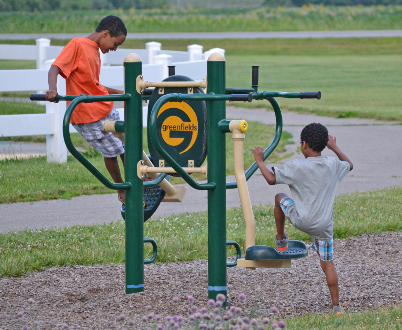 Kids on play equipment at Homestead
