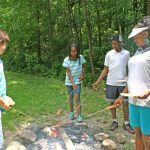 Cook outs are always a hit with kids at summer camps. (Skye Zuza)