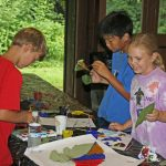 Campers getting creative with paint and leaves at Highbanks. (Skye Zuza)