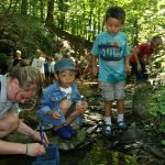 Camp counselor and campers search for critters in a ravine at Highbanks. (Skye Zuza)