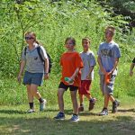 Campers and counselor take a walk through the meadows and woods at Highbanks. (Virginia Gordon)