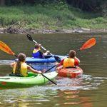 Campers kayak on the Scioto River at Scioto Grove Metro Park. (Virginia Gordon)
