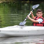 Kayaker on the Dragonfly Day Camp pond at Highbanks. (Virginia Gordon)