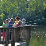 Kids fish from the deck at Highbanks' Dragonfly Day Camp. (Angela Latham)