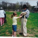 Girl petting lamb