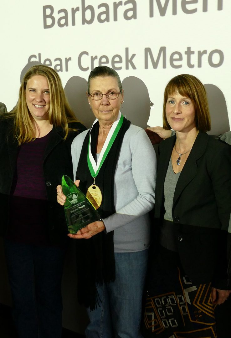 Barbara Merritt with her Volunteer of the Year Award, flanked by Clear Creek Naturalist Marcey Shaffer (left) and Friends of Metro Parks President Kathryn Kelley (right).