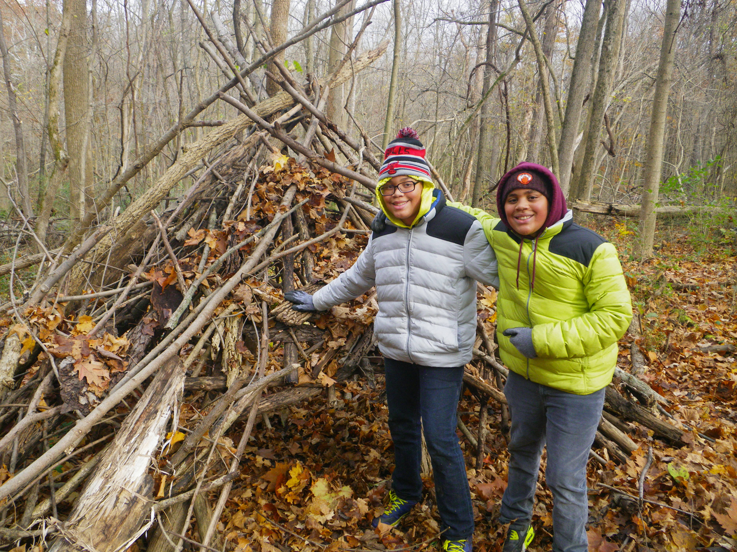 Two kids at the entrance to the fort they built in the natural play area at Sharon Woods. Allison Shaw