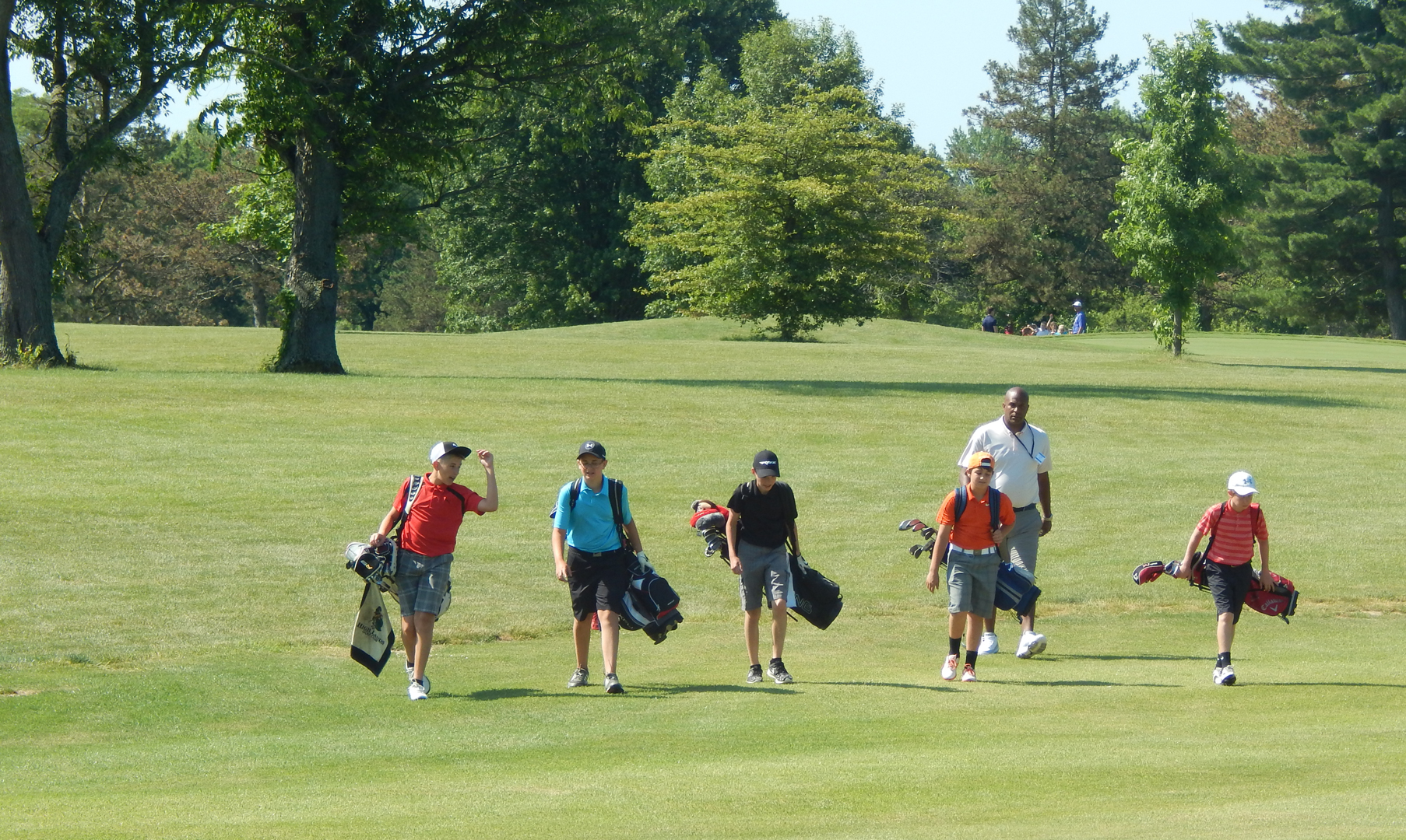 Kids walk the Blacklick Woods Golf Course during a round of golf. Photo by Brandon Ridgley.