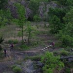 Bikers ride rugged terrain at Quarry Trails