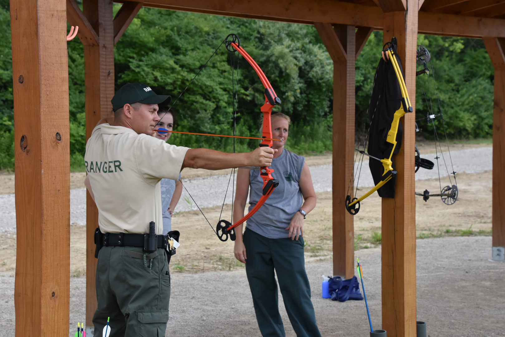 Scioto Grove Manager Geoff Hamilton shoots a compound bow at the static archery course.