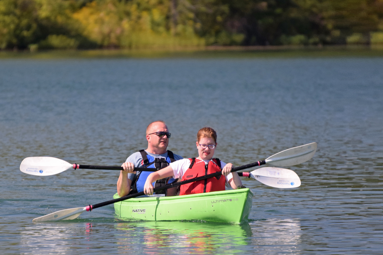 Canoeists on lake for an Outdoor Adaptive Adventures program at Prairie Oaks.