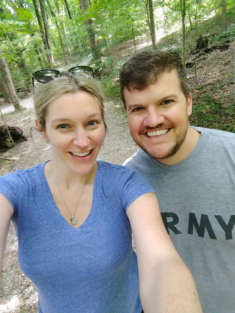 Young couple pose for camera on a trail at Prairie Oaks Metro Park
