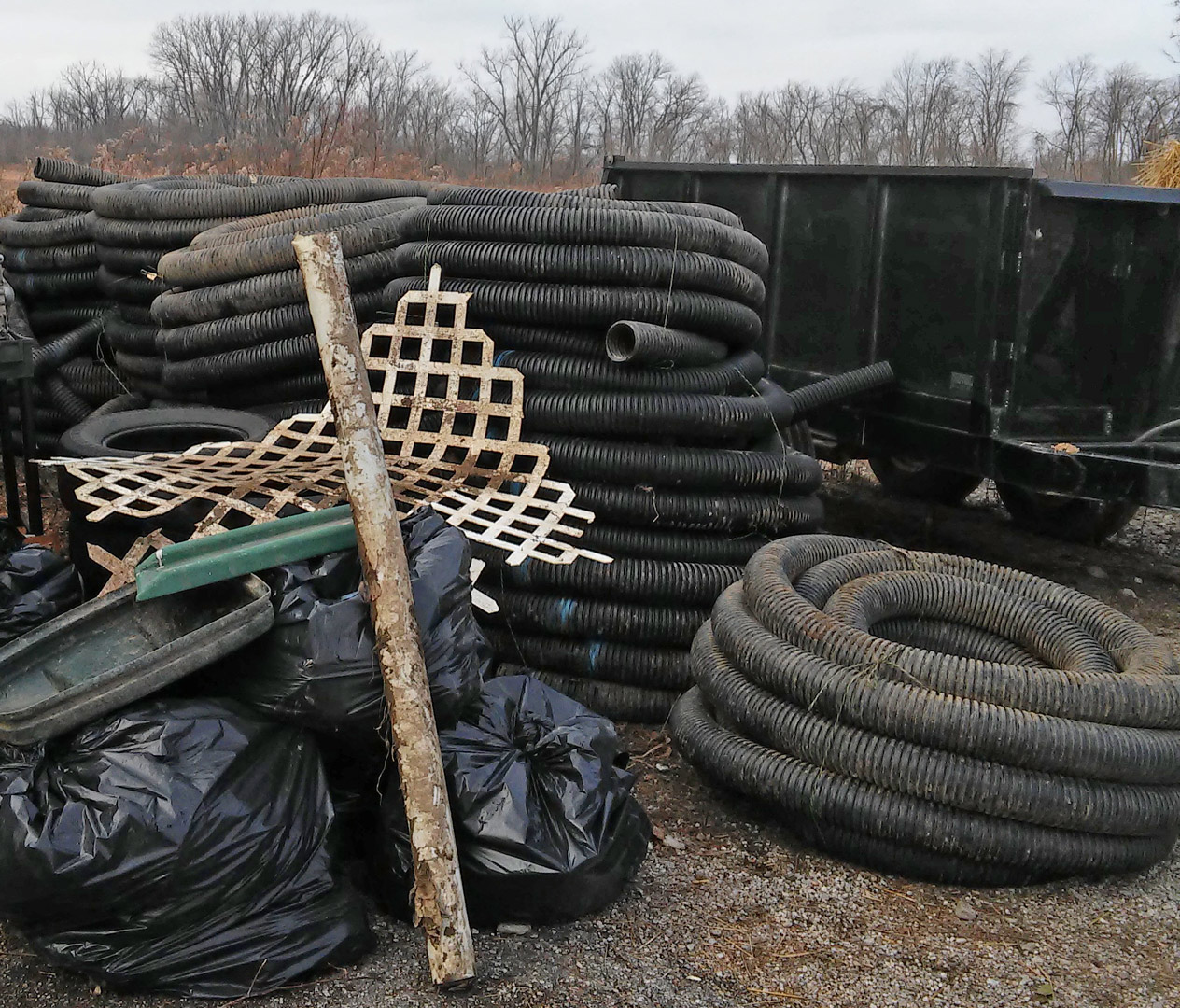 Irrigation pipes and other construction materials were swept into parks by flooding