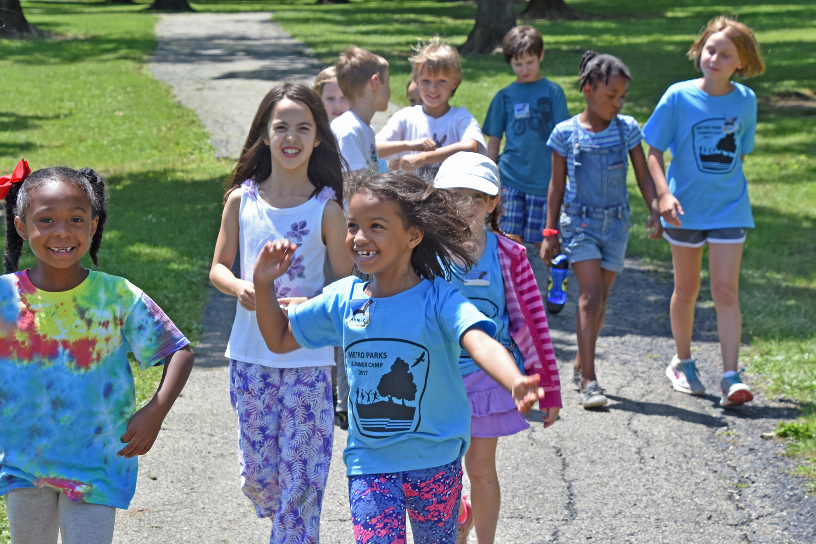 Kids sing and play on adventure camp at Sharon Woods