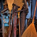 A set of brooms made from broomcorn, a variety of sorghum, in the tool shed at Slate Run Farm