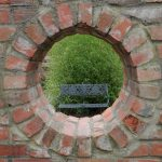 Wall with circular opening in the Secret Garden at Inniswood