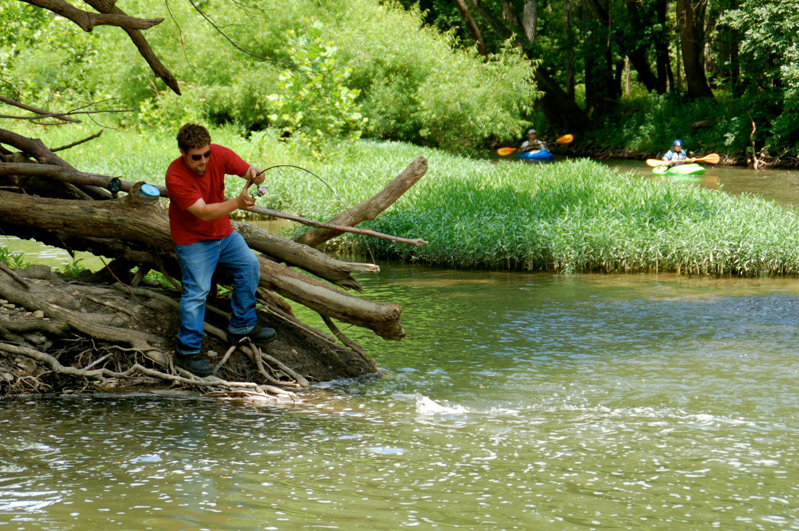 Man catches a fish from banks of Big Darby Creek in Battelle Darby Creek Metro Park