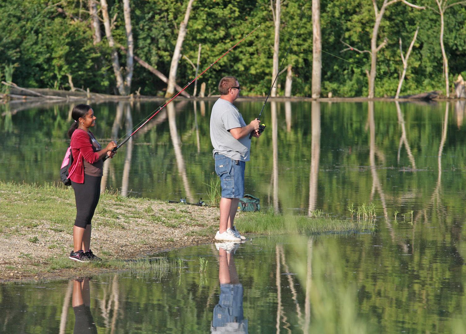 People fishing on Darby Bend Lakes at Prairie Oaks Metro Park