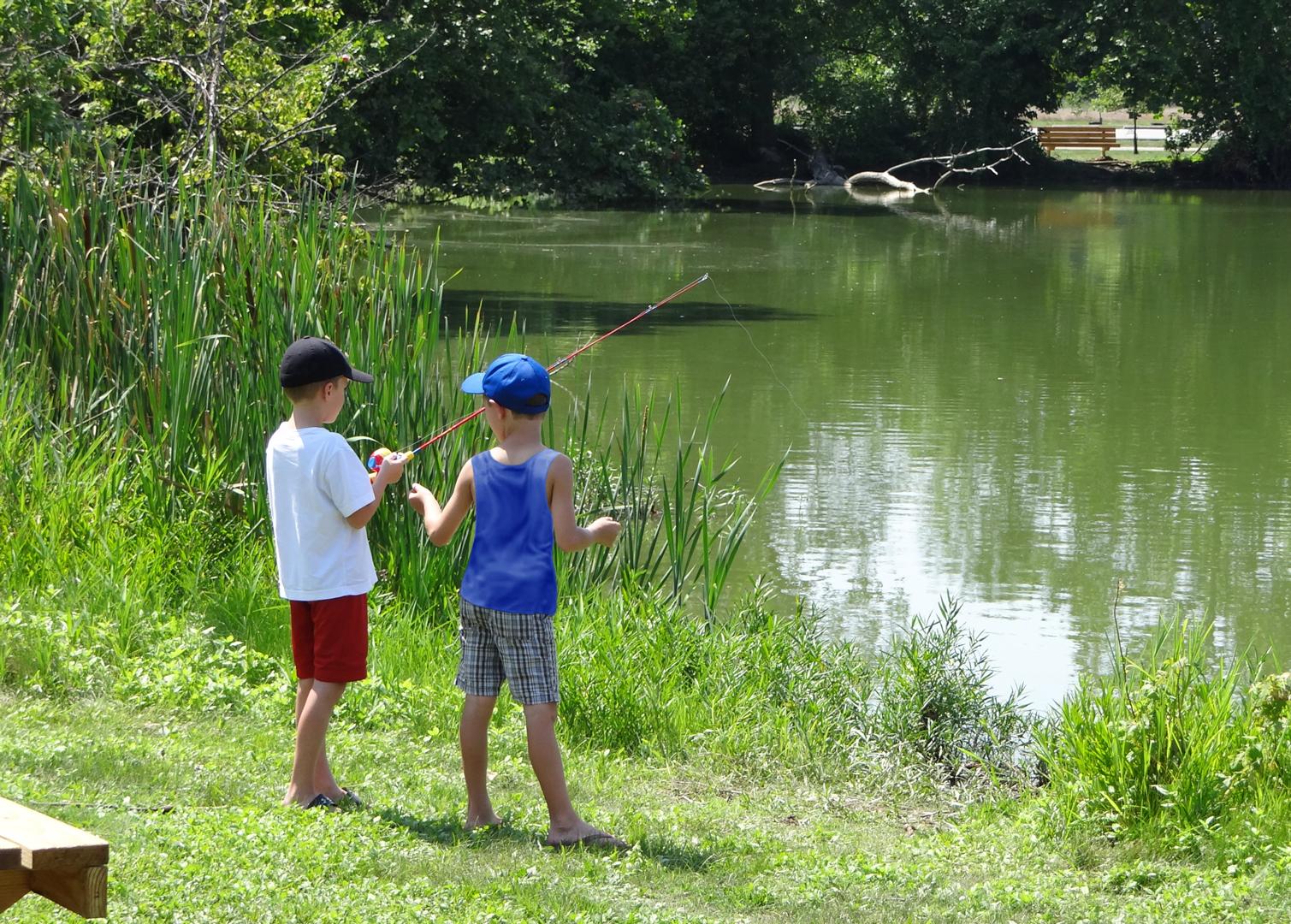 Two boys fish at Heron Pond in Three Creeks Metro Park