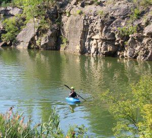 Canoeist on the quarry lake at Quarry Trails Metro Park