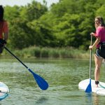 Paddle boarders on the quarry lake at Quarry Trails Metro Park