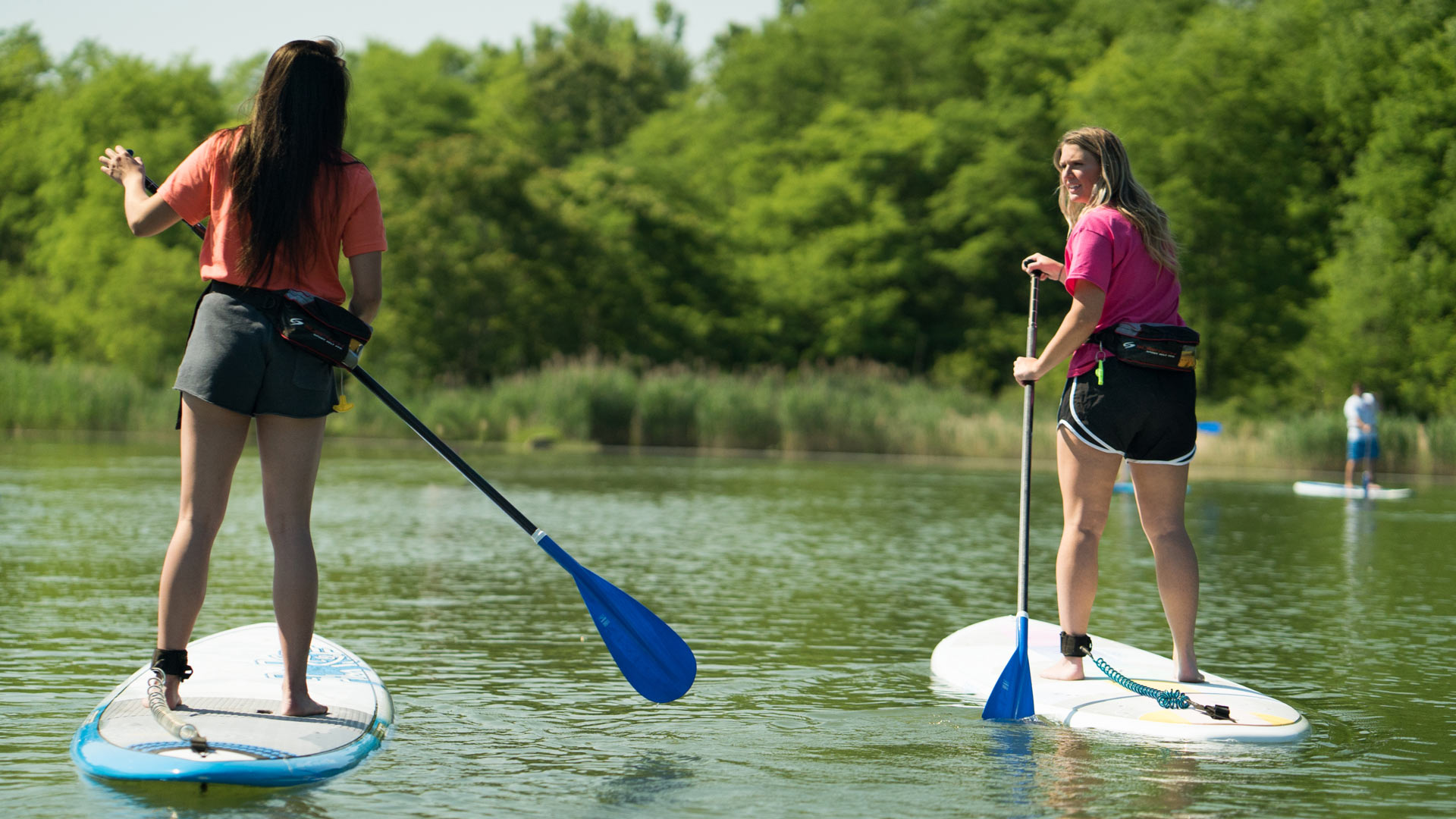 Paddle boarders on the quarry lake at Quarry Trails Metro Park.