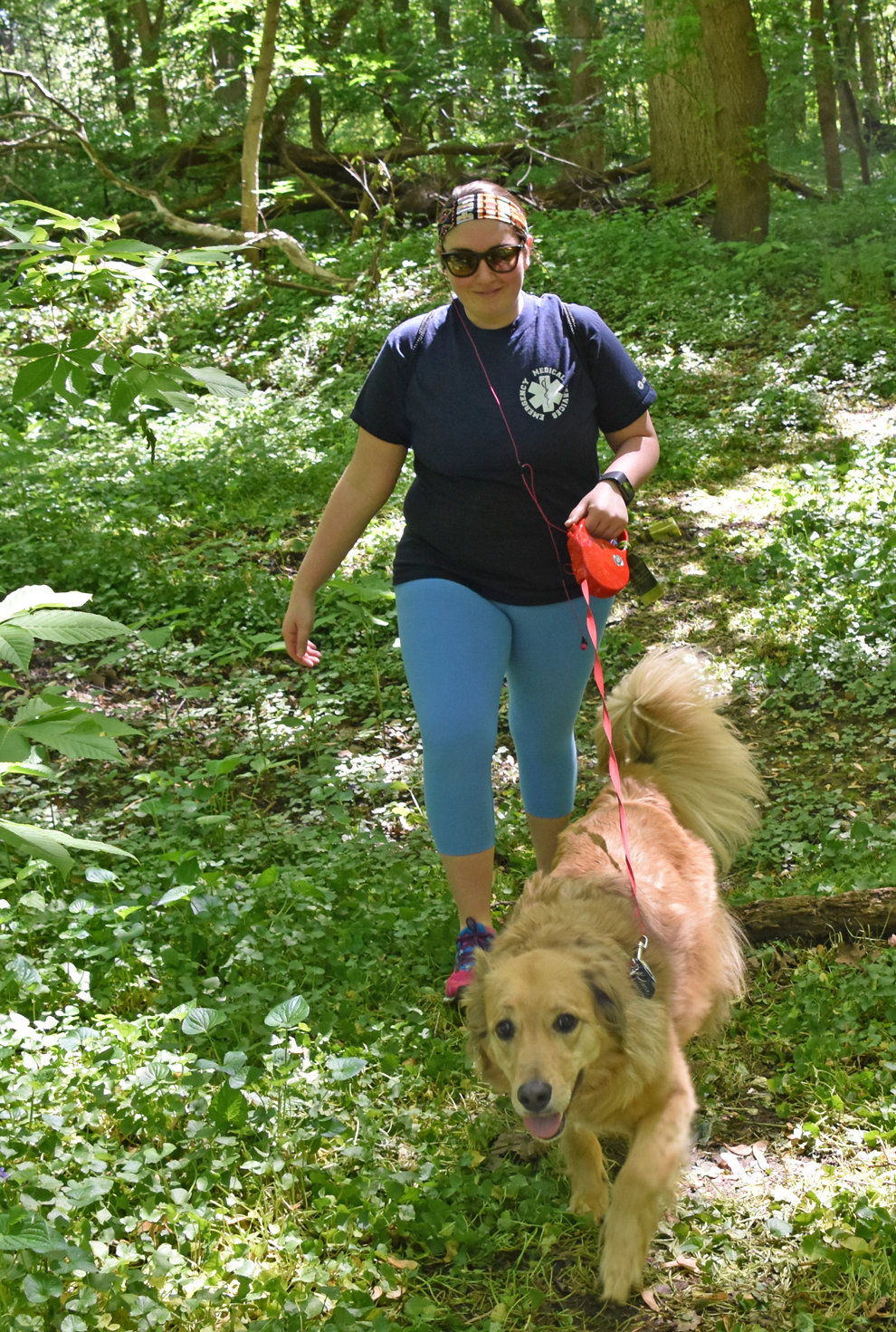 A woman walks with her leashed dog at the pet-friendly Scioto Grove Metro Park
