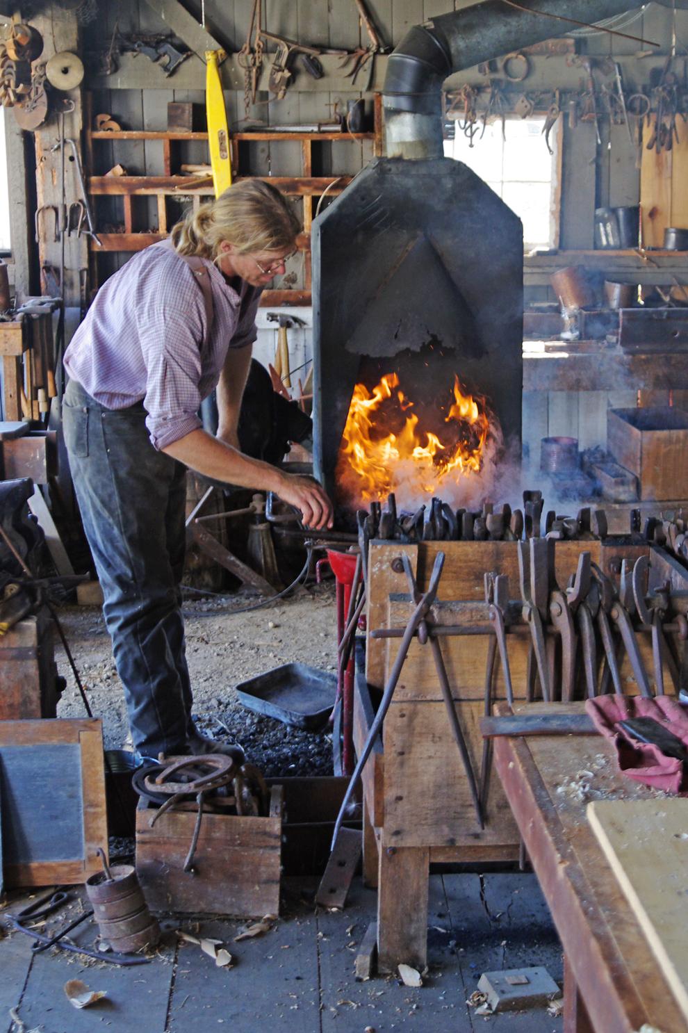 Blacksmith fires the forge at Slate Run Farm