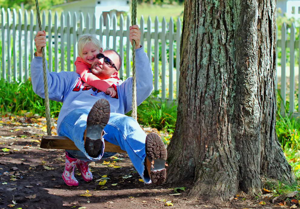 Father and daughter on the maple tree swing at Slate Run Farm