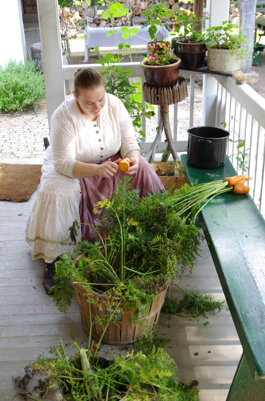 Farm lady prepares carrots for lunch at Slate Run Farm