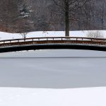 Ice and snow around the bridge over the lake at Blacklick Woods Golf Courses