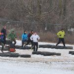 Athletes do the tire run on the obstacle course at Scioto Audubon Metro Park