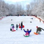 Sledders on the hill at Sharon Woods