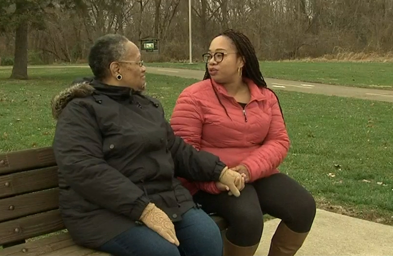 Dana Starks and her mom talk together ona becnh at Three Creeks Metro Park