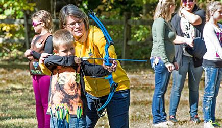 Archery Program boy and volunteer.