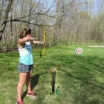 Woman shoots an arrow on an archery program at Blendon Woods