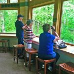 Visitors view wildlife through the Blendon Woods nature center windows