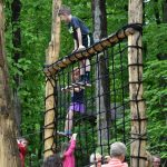 Kids play on the cargo net in the natural play area at Blendon Woods