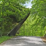 Leaning Lena, a massive slab of rock, overhangs the road in Clear Creek Metro Park
