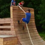 Kids climb play structures at Glacier Ridge Metro Park