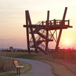 Sun sets behind the observation tower at Glacier Ridge wetlands