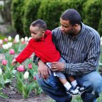 Father and son admire the tulips at Inniswood