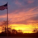 Sunset and the American flag at Prairie Oaks Metro Park