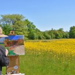 Artist paints a scene in the fields at Rocky Fork Metro Park