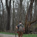 Young boy with backpack walks the trails at Scioto Grove