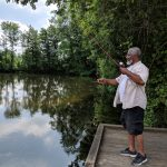 Man fishes on Schrock Lake at Sharon Woods Metro Park