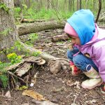 Girl builds a house for an elf in the natural play area at Sharon Woods