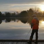 Fishing as the sun rises over Schcok Lake at Sharon Woods Metro Park