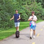 Visitors and their dog on the Alum Creek Greenway Trail at Three Creeks