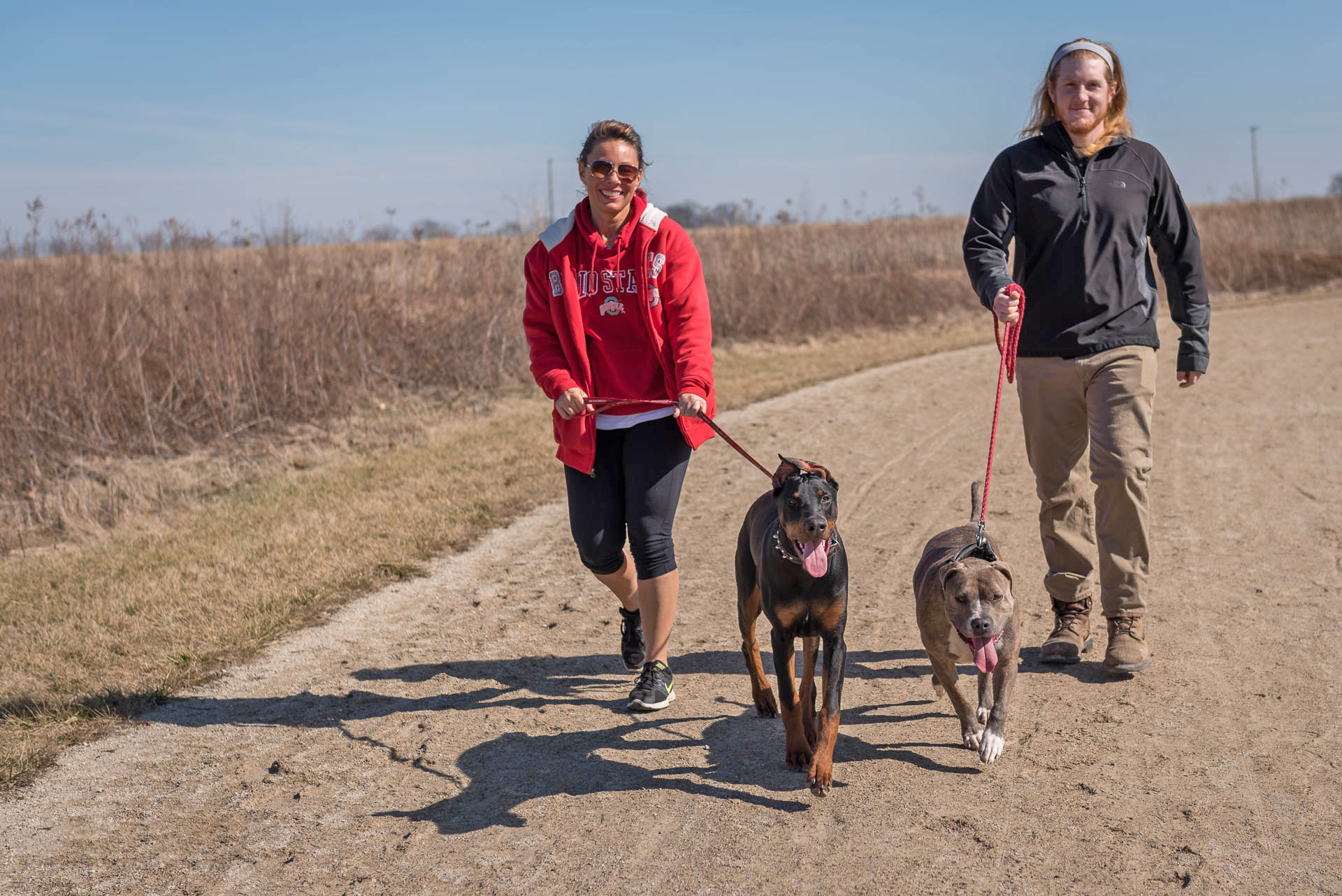 People walk their dogs on the Darby Creek Greenway Trail at Battelle Darby Creek. Photo by John Nixon.